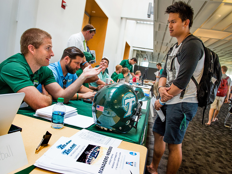 Shihan Yo, right, gets the lowdown on job opportunities with Tulane Athletics communications from Josh Bates, assistant director of athletic communications, during the Student Job Fair on Tuesday (Aug. 25.) in the Lavin-Bernick Center for Community Life.